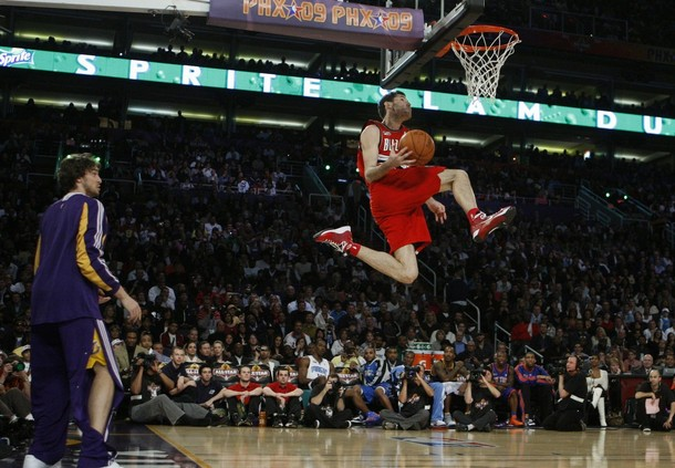 Portland Trail Blazers Rudy Fernandez is assisted by Los Angeles Lakers Gasol as he competes in the Slam Dunk contest at NBA All-Star weekend in Phoenix