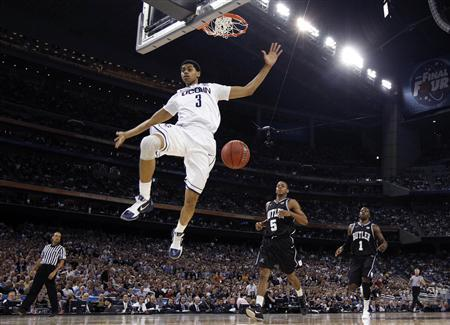 Huskies' Lamb dunks against the Bulldogs during their men's final NCAA Final Four College Championship basketball game in Houston
