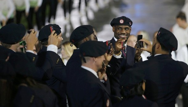 Basketball star James smiles as he walks with the United States delegation in the athlete's parade in the opening ceremony of the London 2012 Olympic Games