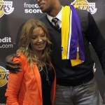 Los Angeles Lakers Vice President Buss and Howard hug at press conference at Lakers practice facility in El Segundo, California