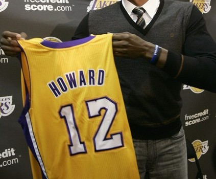 Howard holds his new Los Angeles Lakers jersey during a press conference at Lakers practice facility in El Segundo