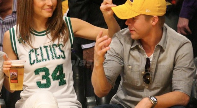 Maria Menounos shows her Celtic Pride as she and her Dancing With The Stars partner Derek Hough watch the Los Angeles Lakers Vs the Boston Celtics