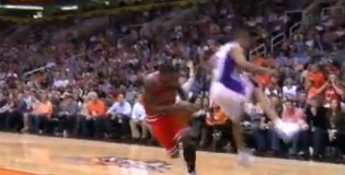 Nate Robinson fakes then ducks under a flying Sebastian Telfair
