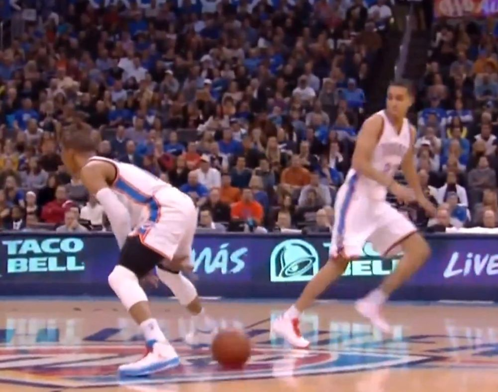 Russell Westbrook passes under his own legs to get KevMart the jam