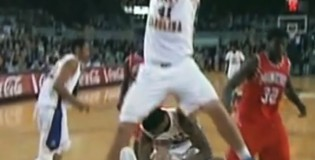 College player dunks & hangs on the rim while teammate punches defender under him