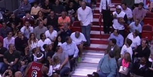 LeBron Passes The Ball Back And Forth With a fan during the game