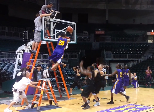 Rick Fox dunks on a few players during the filming of a TV show…with the help of a ladder