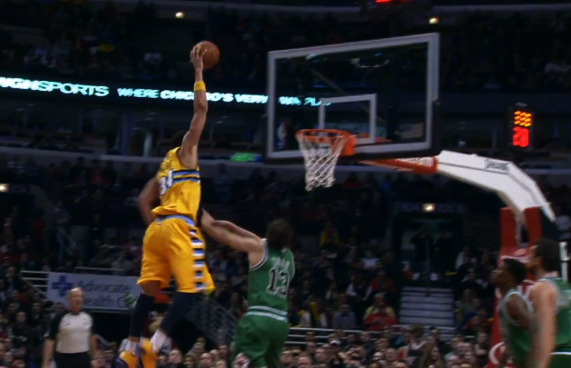 Javale McGee gets way up for the throw-in dunk against the Bulls