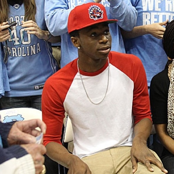 andrew wiggins attends unc game wearing a raptors hat