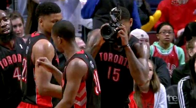 Amir Johnson Picks Up a Camera In The Middle of The Game & Starts Snapping Pictures