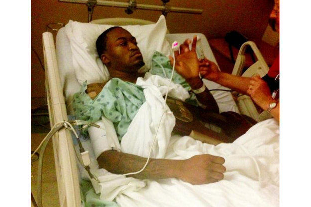 IMAGE OF THE DAY: Kevin Ware in hospital with the Midwest Regional Championship Trophy