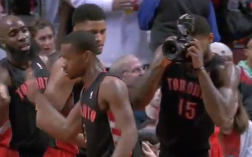 Amir Johnson takes pictures of his teammates during the game