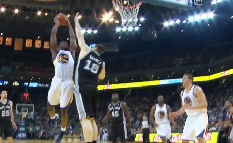 Harrison Barnes dunks over Spurs Aron Baynes causing a fan to suck his thumb