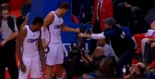 NBA employee acts like Blake Griffin is trying to steal a camera after he crashes into cameraman