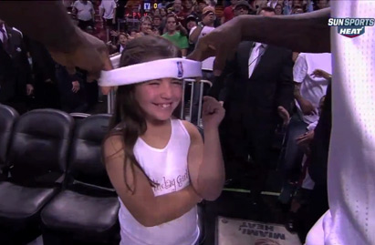 LeBron gives little girl his headband and a kiss after the Celtics game.