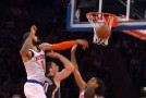 Tyson Chandler volleyball spikes Tyler Hansbrough's shot as JR & Raymon hug for the cameras