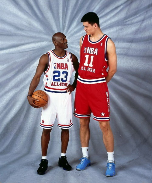 Jordan and Yao Ming pose for a portrait