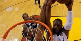Dwyane Wade wakes up Tim Duncan with a 2 hand dunk
