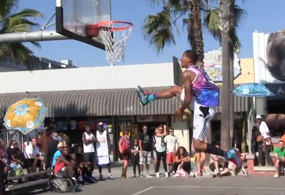 Guy Dupuy self bounce between the legs dunk during a game at the VBL