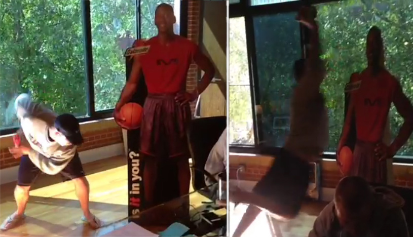 Guy dunks on and destroys a life-size Michael Jordan cut-out