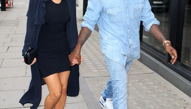 Kim Kardashian and Kanye West holding hands as they arrive at the Hakkasan-842704