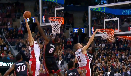 Jonas Valanciunas dunks (on/over/by?) LeBron James