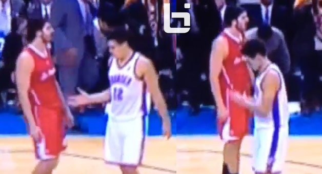 OKC's Steven Adams shakes his own hand after Byron Mullens leaves him hanging