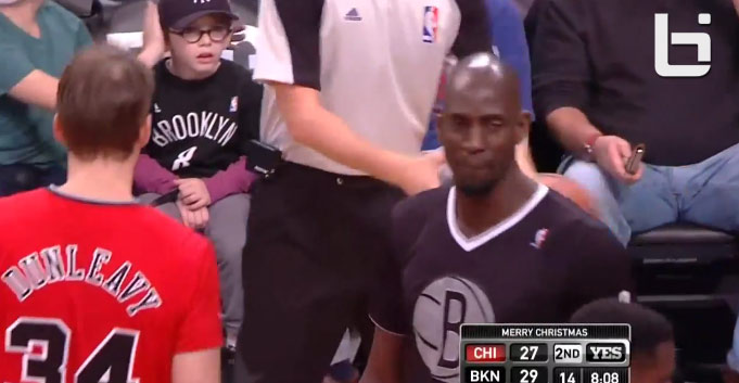 Brother covers his younger brother's ear so he can't hear Kevin Garnett cursing