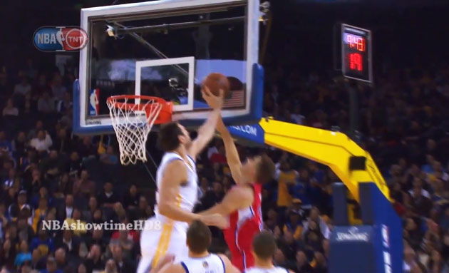 Andrew Bogut pins Blake Griffin's layup against the backboard