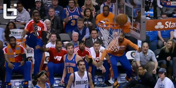 The Knicks bench reacts to Carmelo Anthony missing a dunk