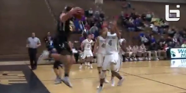 High school player accidentally makes a lucky bounce shot while trying to save the ball