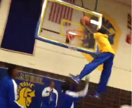 Students go crazy after 4'11 kid dunks (with some help) at a pep rally