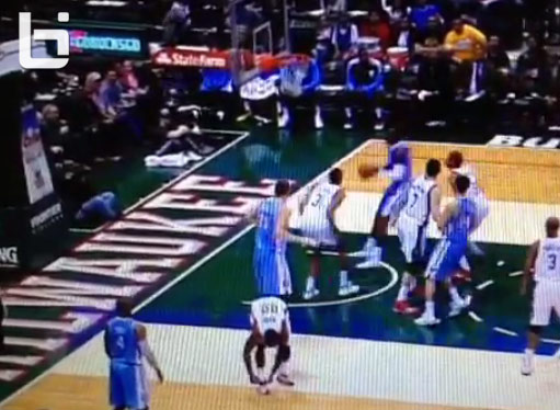 O.J. Mayo ties his shoes during the game while his team is on D