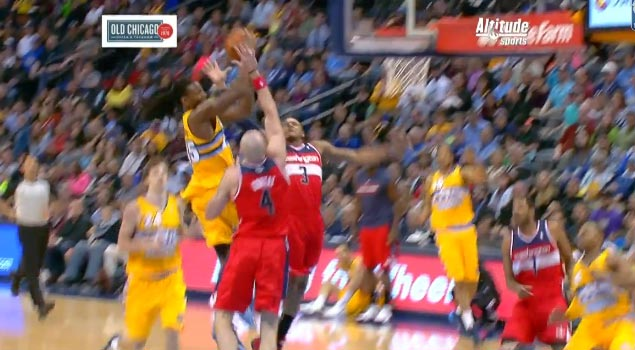 Bradley Beal volleyball spikes Kenneth Faried's shot off the glass