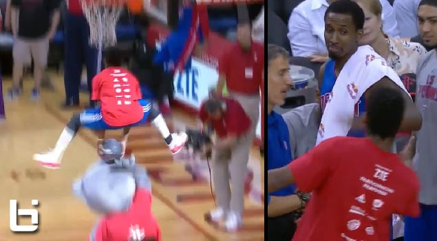 Brandon Jennings looked impressed with Sir Isaac's halftime dunk over the Rocket's mascot