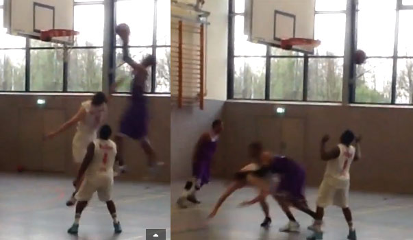 Defender gets knocked to the floor on an off the glass oop