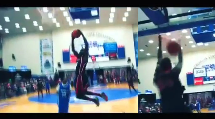 Mr Afrika changes his mind in mid-air and does a different dunk