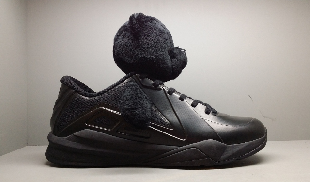 Metta World Peace & his new removable Panda head sneakers