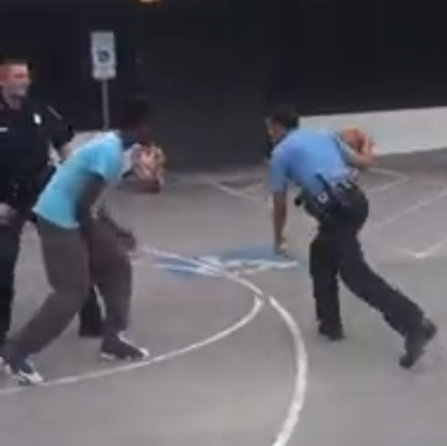 Houston Cops playing basketball with kids, they even bought the kids drinks