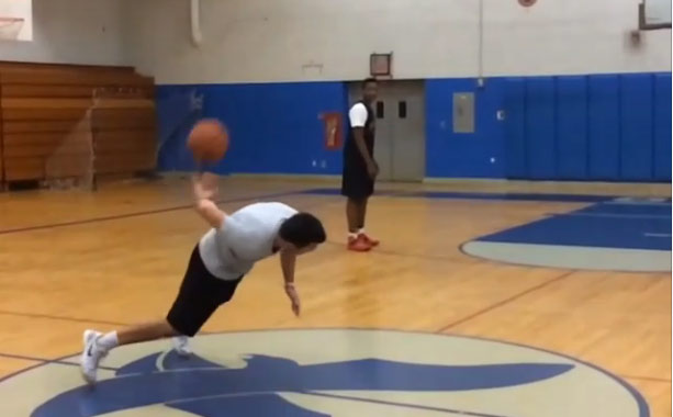 NBA Skills Coach hits a push-up/behind-the-back trick shot from half-court