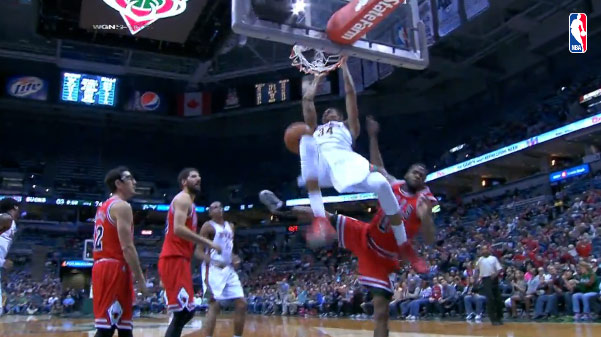 Giannis Antetokounmpo with the block on one end and dunk on the other