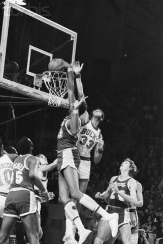 Wilt Chamberlain Dunking Basketball